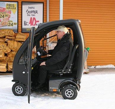 Elektrisk rullestol med kabin